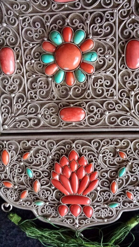 Barga women's chest pendants. Turquoise and coral inlaid on silver filigree surface.