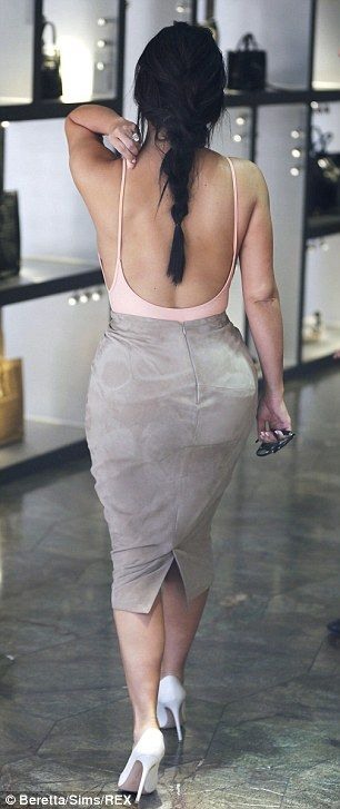 Just peachy! Kim's Kardashian ensemble was just as impressive from the back, with the scoop design of her vest drawing the eye downwards towards her world-famous derriere