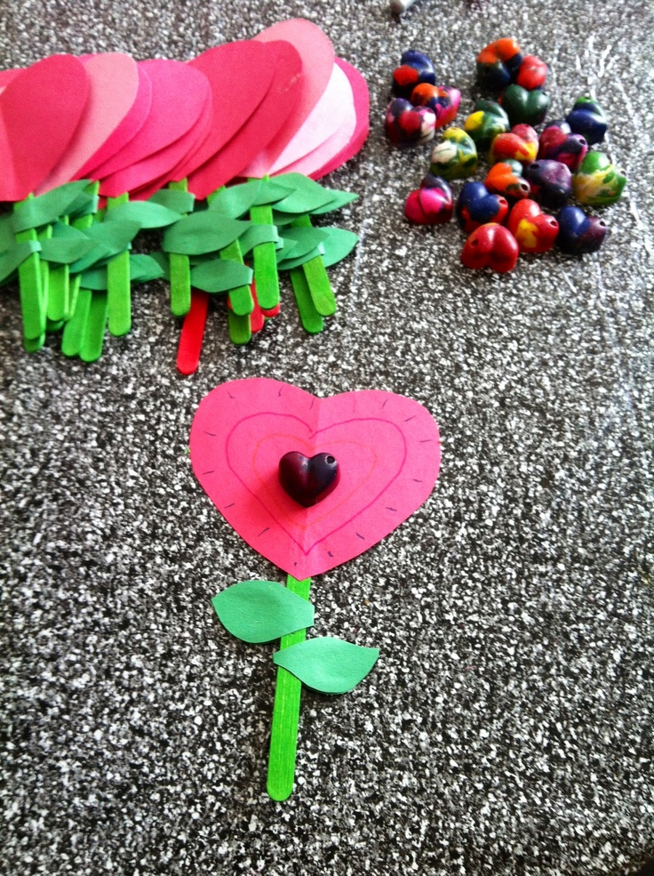 Homemade crayon hearts on a heart flower!! The perfect preschool valentine craft for little kids!! (And easy to make enough for the whole class!)