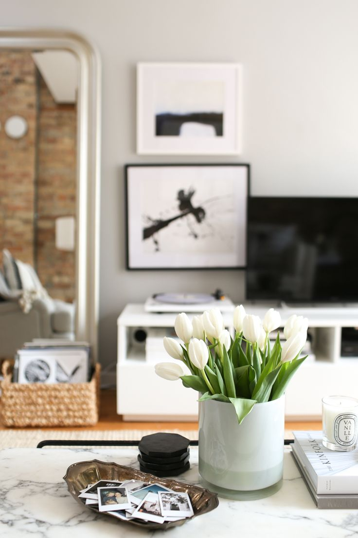 The Everygirl Co-founder Danielle Moss' Chicago Apartment Tour #theeverygirl    neutral interiors, white couch, jute rug, marble coffee table, exposed brick, floor length mirror, instax photos