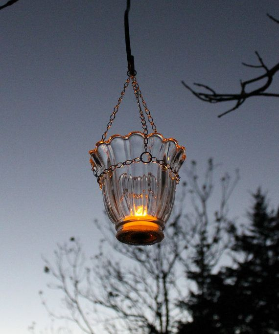 Glass Hanging Votive Candle Luminary  Tea Light by SeventhChild.I have some ceiling fan light globes like these.I will hang mine from the smaller end and put a solar light in the top.