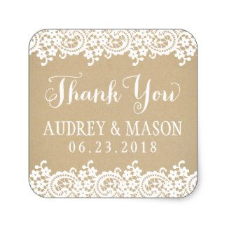 """Wedding favor stickers in square shape feature """"Thank You"""" in white script, a monogram of the bride and groom's names and wedding date, a charming illustrated border design of floral lace, and a background with a rustic kraft brown paper textured appearance."""