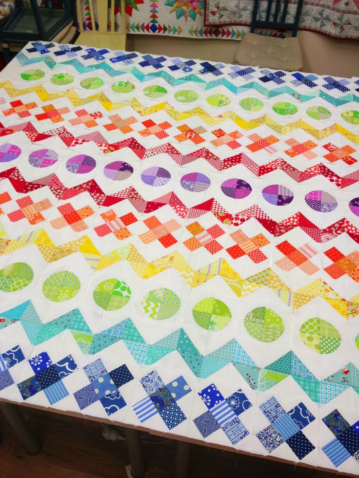 Row by row rainbow quilt.  Quite nice now each row is a different shape!