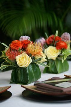 tropical wedding centerpiece ideas with large folded leaves ...