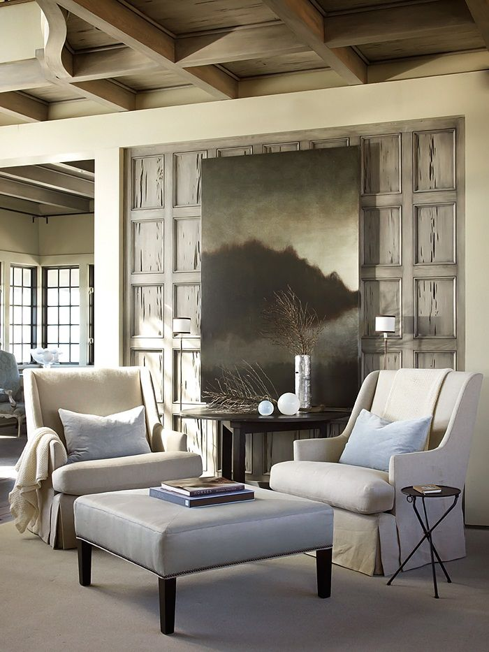 What a cozy spot. I love the natural wood coffered ceiling, the art and the weathered shutters in the niche....V