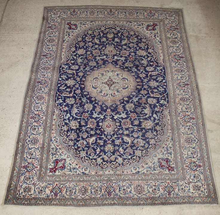 """Lot 827, A fine Persian blue and white ground Nain carpet 136"""" x 94"""", sold for £200"""