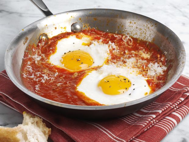 Eggs in Purgatory Recipe: Simmer 1 Cup spaghetti sauce (& seasonings to taste if desired), Add two eggs, cover & simmer until whites have set. Top with pepper & cheese if desired. Serve with bread/toast.  YUM.