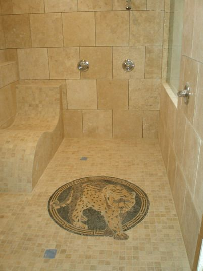 minus the animal and add a shower head above the seat - Walk In Shower Design Ideas