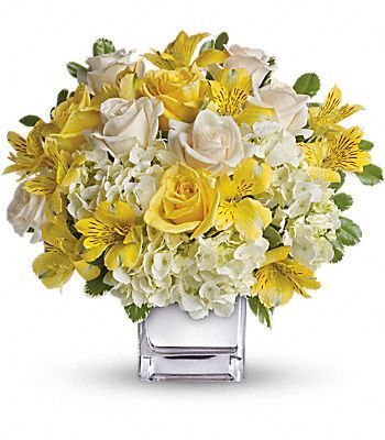white and yellow flower arrangements