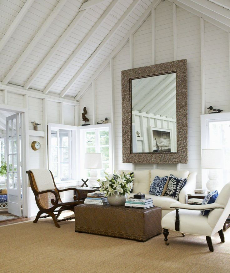 Love the Bombay chairs with rich ebony wood contrasted with the crisp white walls, Inkat pillows in a blue pattern