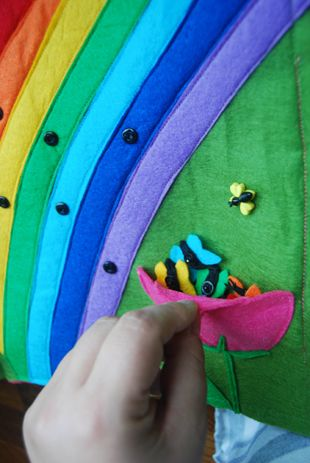 Busy book rainbow page . . . take the butterflies and stick them o the rainbow . . . motor skills and color matching.