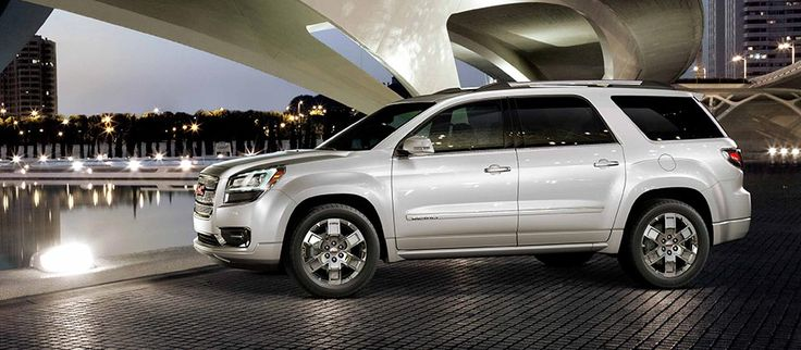 The 2016 GMC Acadia Denali mid-size luxury SUV in white diamond tricoat