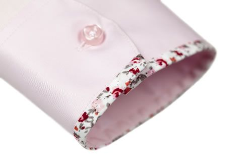 bespoke shirt. Bespoke is the past tense of bespeak, meaning made to order. This is a cute detail that would be easy to duplicate.