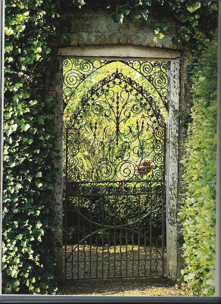 Wrought Iron Gate In A Garden Wall.