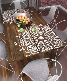 Stenciling a wooden table can add beautiful detail and interest. | Deloufleur Decor & Designs | (618) 985-3355 | www.deloufleur.com