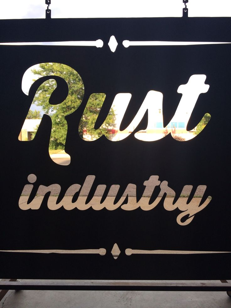 Rust Industry.  This sign welcomes visitors to the industrial art garden that hides behind the main shop.
