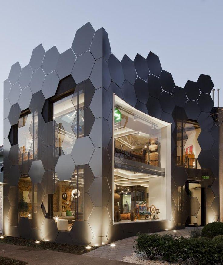 SuperLimão Studio have designed a honeycomb inspired facade, full of hexagonal shapes, for the Estar Móveis shop in São Paulo, Brazil.
