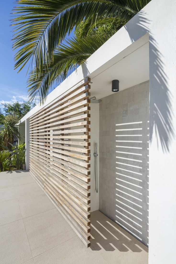 The shower in this palm-lined home on Arch Daily is tucked away and hidden pretty nicely.