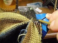 How to hang a hem on a circular sock knitting machine.