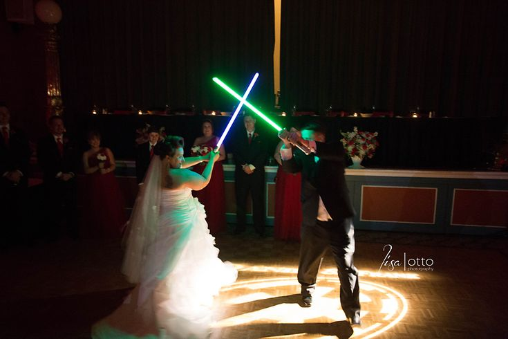 Lightsaber duel first dance instead of a traditional first dance.  Danie and Frank | Safety Harbor Spa Wedding with a Star Wars theme