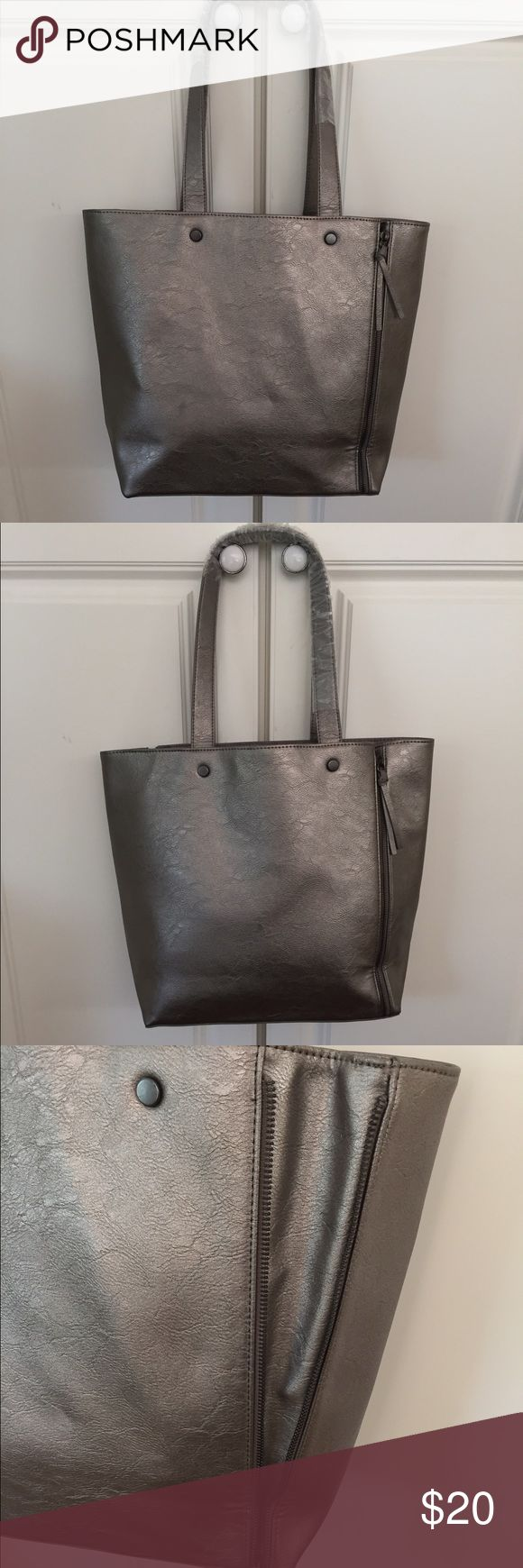 "Neiman Marcus Silver/Pewter Tote NWOT Dull silver Tote from Neiman Marcus. New with plastic still on handles; no sales tag. Faux leather. About 16"" across top, 13"" high, 10"" strap drop. 👗👚👜Check out the $6 section of my closet (before the sold items). Lots of bundle-worthy $6 items! 15% bundle discount on 2+ items in a bundle.🚫NO TRADES🚫 Neiman Marcus Bags Totes"