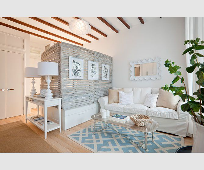 Using a bright, unified color palette creates the illusion of openness within any space.  Choosing one item that matches your style, such as a rug, couch or wall art will give a great pop of color.  Also in this design they used whitewashed pallets attached to a trundle bed to create  separation & privacy between sleeping & living areas.  The pallets provide wall space for displaying ar toot.  Don't forget mirrors which give the illusion of more space.  This design is one of my favs!