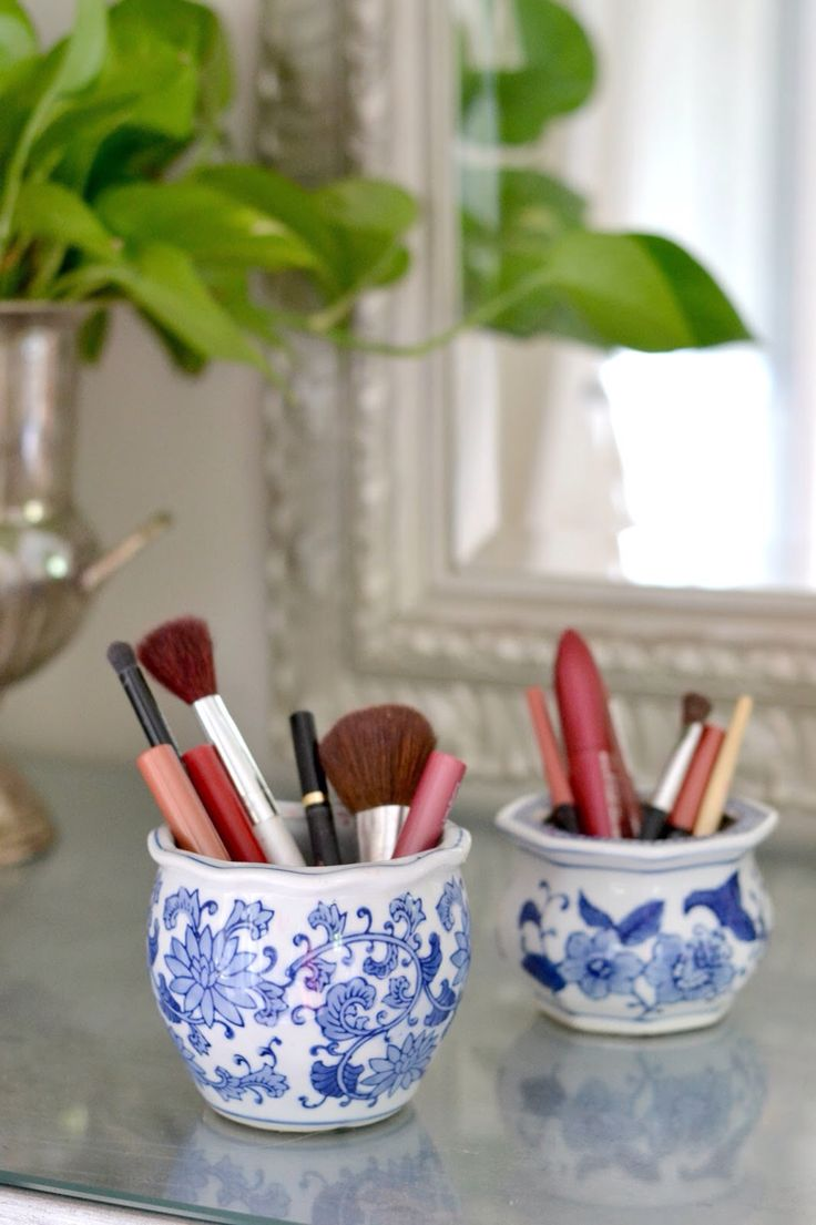 Collect all of your makeup and brushes in garage sale finds, and they're pretty enough to leave out all the time.