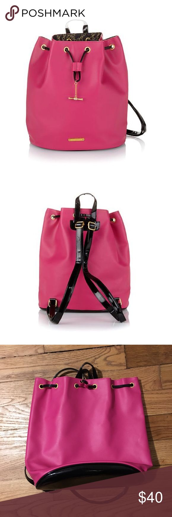 "JUICY COUTURE hot pink drawstring backpack Hot pink drawstring backpack with black trim  Perfect for a night out or during the day 2 patent leather adjustable straps and a patent leather accent base Golden metal chain, logo plaque and taggle Approx. 30""L x 6-1/3""W x 34""H Textured plastic body with patent plastic trim and polyester lining Bags"