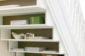 Build an Under-Stair Bookshelf - home depot includes directions for this how-to -- a great idea to create extra storage at the top of basement stairs, or to create an under-the-stairs office area