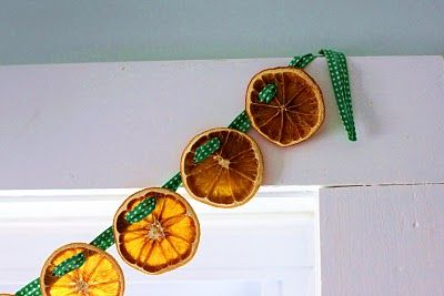 Dried Orange Garland - dry seedless orange slices in the oven.  Simple and very pretty!  via flower patch farmgirl