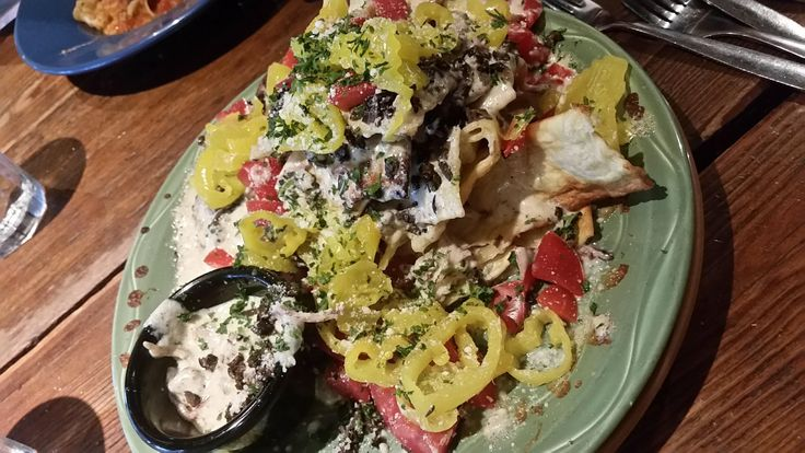[I ate] nachos all italiana - Fried pasta sheets with melted mozzarella and a meatball prosciutto alfredo sauce http://ift.tt/2r1Leey