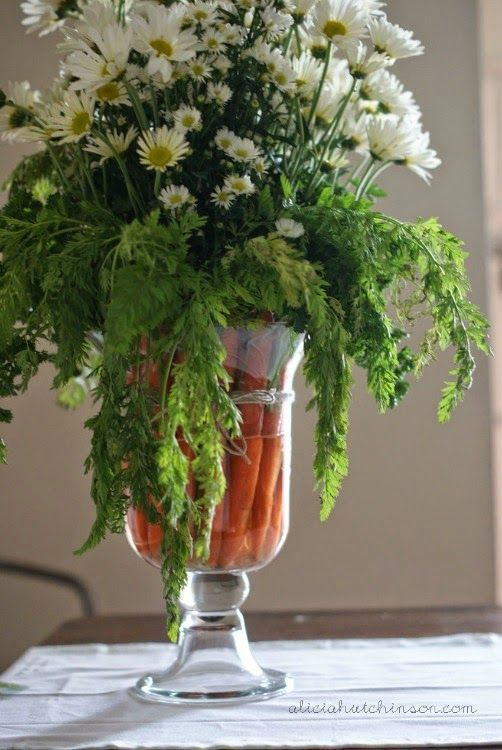 Arrangement with carrots and daisies