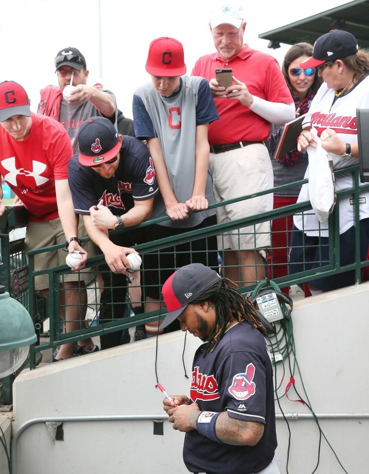 Cleveland Indians Michael Martinez signs autographs for Indians fans before the game against the Chicago Cubs at Sloan Park in Mesa, Arizona on Feb. 26, 2017.  (Chuck Crow/The Plain Dealer)