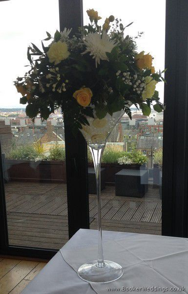 Yellow and white wedding flower theme in a tall martini glass for a table centrepiece at the Hope Hotel, Liverpool | Wedding Flowers Liverpool, Merseyside, Specialist Bridal Florist Liverpool, Booker Flowers and Gifts, Booker Weddings