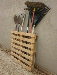 Garage Organization on a budget!  Pallet hooked to wall to store yard tools