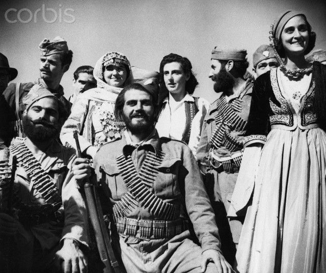 A mixed group of Greek irregular soldiers and partisans happily pose as they celebrate the liberation of their country at the end of the Second World War. Greek partisans together with British paratroopers drove the German army from Athens after three and a half years of occupation. Papandreous raised the Greek flag over the Parthenon in front of an enthusiastic crowd on October 18th, 1944.