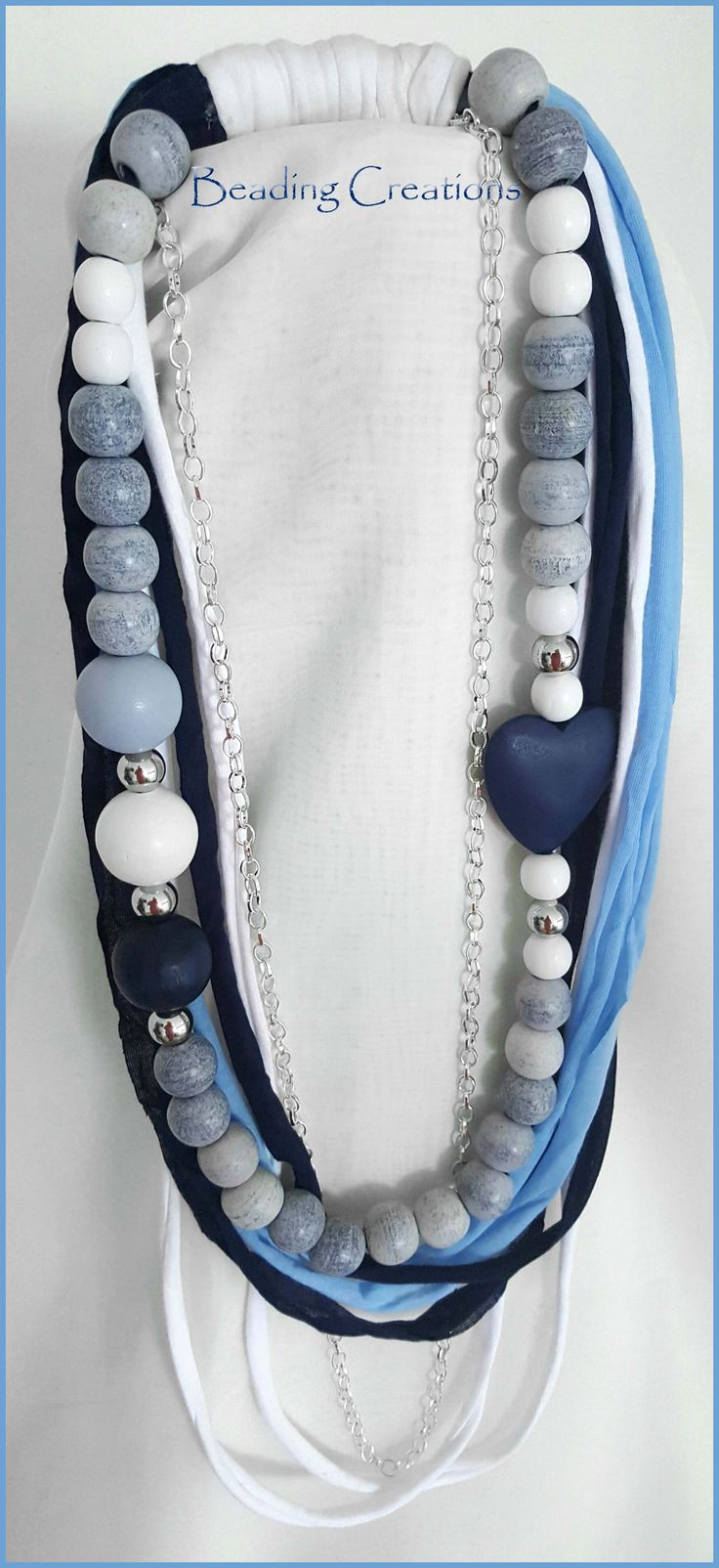 NEW HANDMADE ONE OF A KIND DESIGNER WOODEN BEADS AND T-SHIRT YARN NECKLACE IN WHITE, NAVY BLUE AND BABY BLUE WITH A CONTRAST OF STONEWASHED DENIM BLUE WOODEN BEADS AND NAVY BLUE WOODEN HEART AVAILABLE FOR R150.00 AT: http://www.bidorbuy.co.za/seller/366992/Beadingcreations
