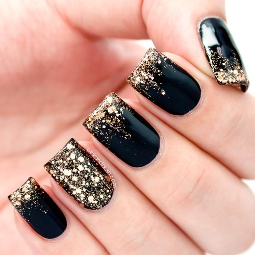Midnight sparkles! Black polish with gold sparkles and a clear coat. Gorgeous nails to wear with an evening dress or just be super girl casual #sparkles
