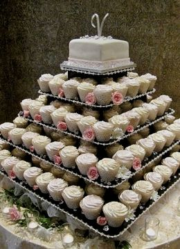 """39.99 SALE PRICE! . Large Square Cupcake Tree holds up to 300 cupcakes Eco Friendly. Size: 21"""" high - 34"""" wide 4"""" between tiers. Cupcakes:..."""