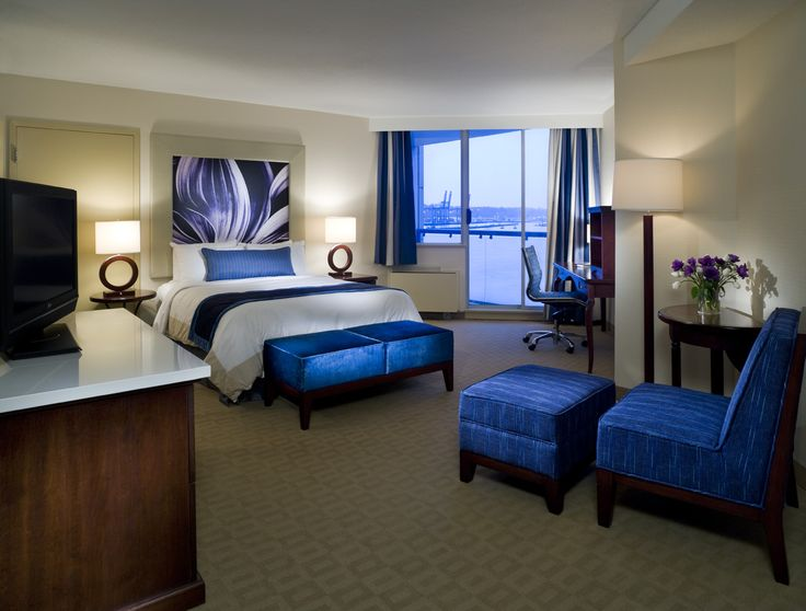 Queen guestroom with balcony which makes you think you are on a cruiseship without the sea sickness.