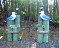 3 posts similar to this at the end of the driveway  Wooden Pilings for Custom Nautical Lawn Decorations