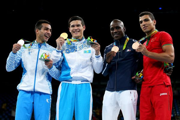 Shakhram Giyasov of Uzbekistan poses with the silver, Daniyar Yeleussinov of Kazakhstan with the gold, Souleymane Cissokho of France and Mohammed Rabii of Morocco win the bronze medal in Men's Welterweight boxing during Day 12 of the Rio 2016 Olympic Games at Riocentro - Pavilion 6 on August 17, 2016 in Rio de Janeiro, Brazil.