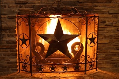"Wouldn't thisTexas Star fireplace screen be perfect for those ""chestnuts roasting on an open fire"" kind of December night ;-)"