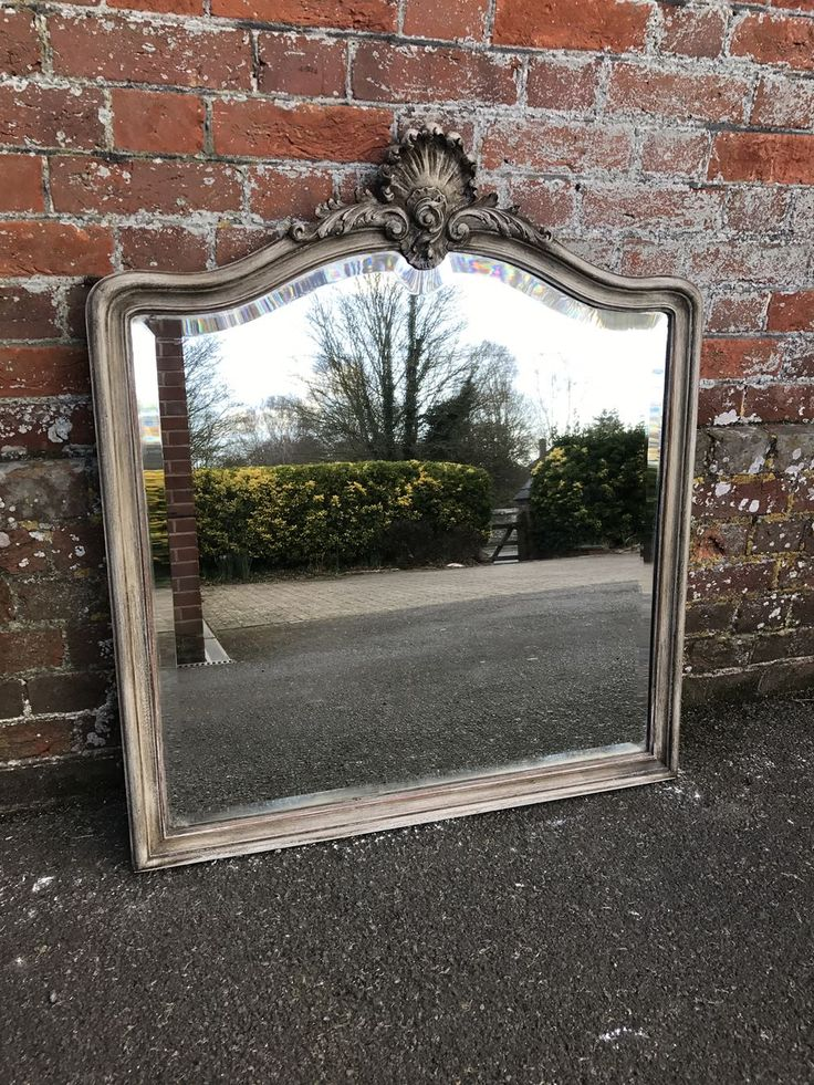 An Exquisite good size Antique 19th Century French carved wood painted shaped top Mirror.