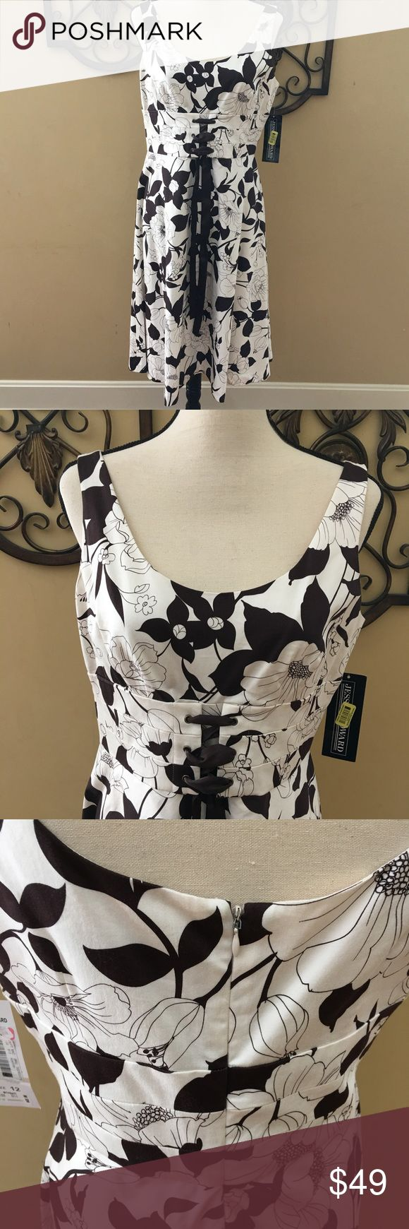 NWT Jessica Howard dress in size 12 NWT Jessica Howard flower dress in size 12. Under bust corset look with brown ties. Fit and flare dress. Very pretty. Jessica Howard Dresses Midi