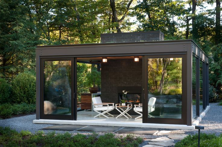 Glass House In The Garden / small glass-walled building in a backyard with a tearoom and a bonsai greenhouse / by Flavin Architects & Zen Associates