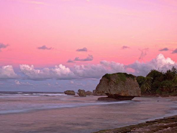 Weathered formations like Mushroom Rock dot the white-sand beaches of Bathsheba on the rugged east coast of Barbados.