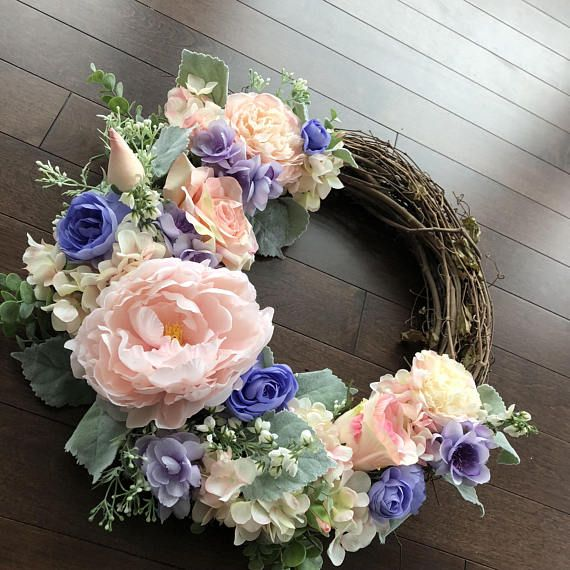 One of my favorite things about spring is the colors and the pastels that spring out in nature. This wreath captures all of that and more. Brighten up your door with a feminine and flowing design that encompasses texture and interest to anyone that passes by! The style you are viewing is