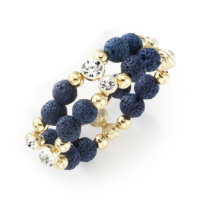 Esta hermosa pulsera se caracteriza por sus eslabones con 4 baños de oro de 18 kilates donde encontramos pares de piedras de cristal que le otorgan un toque super femenino y chic.