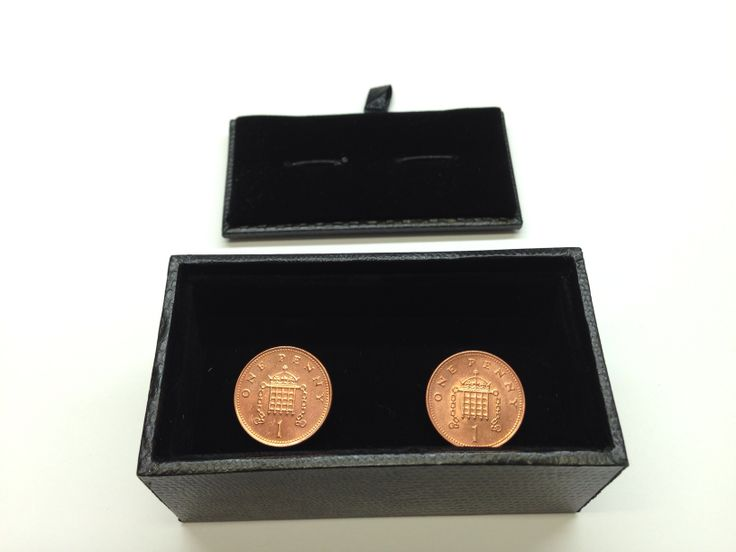 """British penny cufflinks.  The original reverse of the coin, designed by Christopher Ironside, and used from 1971 to 2008, is a crowned portcullis with chains (an adaptation of the Badge of Henry VII which is now the Badge of the Palace of Westminster),[2] with the numeral """"1"""" written below the portcullis, and either NEW PENNY (1971–1981) or ONE PENNY (1982–2008) above the portcullis.[2]"""